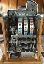 mechanical slot machine assemblies, genuine slot machines, counterfeit mechanical slot machines